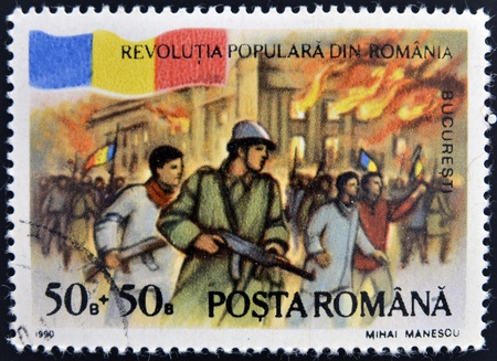 ROMANIA - CIRCA 1990  stamp printed in Romania dedicated to popular revolution shows Palace on fire, Bucharest, circa 1990  Stock Photo - 12465145