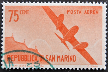 SAN MARINO - CIRCA 1950: A stamp printed in San Marino shows aircraft in flight, circa 1950