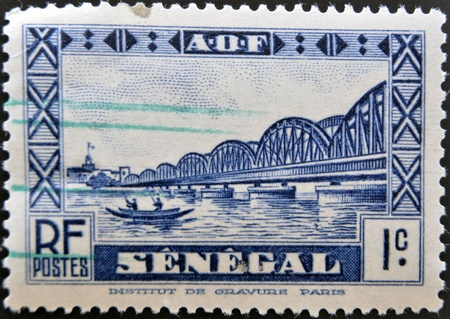 SENEGAL - CIRCA 1931: A stamp printed in Senegal shows Faidherbe Bridge, circa 1931.