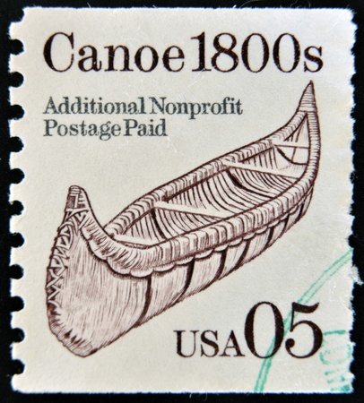 UNITED STATES OF AMERICA - CIRCA 1990: A stamp printed in USA shows canoe 1800s, circa 1990 photo