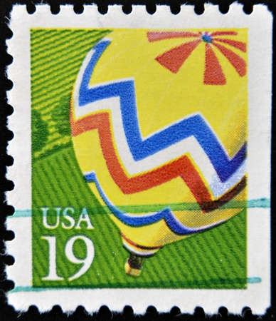 UNITED STATES OF AMERICA - CIRCA 2000  A stamp printed in USA shows Hot Air Balloon yellow, circa 2000 Stock Photo - 12465126