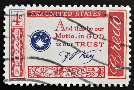 credo: USA - CIRCA 1960   A stamp printed in the USA shows Credo, and this be our Motto, in GOD is our TRUST, circa 1960  Editorial
