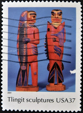 tlingit: UNITED STATES OF AMERICA - CIRCA 2004  A stamp printed in  USA shows tlingit sculptures, Indian Art, circa 2004 Editorial