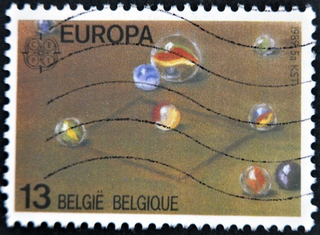 BELGIUM - CIRCA 1989: A stamp printed in Belgium shows marbles, circa 1989 Stock Photo - 12465233