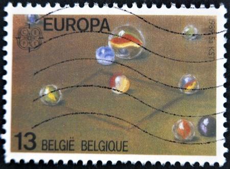BELGIUM - CIRCA 1989: A stamp printed in Belgium shows marbles, circa 1989 Stock Photo - 12465233