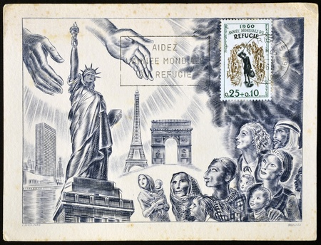 FRANCE - CIRCA 1960: A stamp printed in France dedicated to international year of the refugee, shows open hands to welcome the refugees in usa and europe, circa 1960