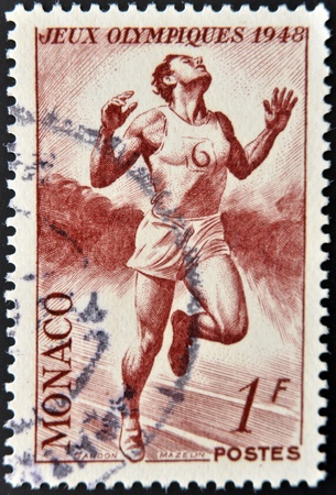 MONACO - CIRCA 1948: A stamp printed in Monaco dedicated to London Olympic Games, shows athlete running, circa 1948