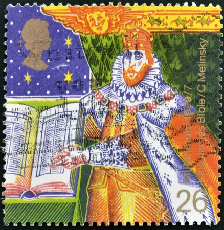 king james: UNITED KINGDOM - CIRCA 1999: A stamp printed in Great Britain shows the King James I of England with the Bible, circa 1999