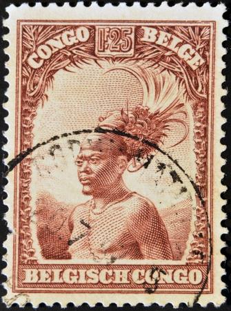 BELGIAN CONGO - CIRCA 1942: A stamp printed in Belgian Congo shows Head of a native men, circa 1942  Stock Photo - 12531936
