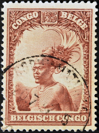 BELGIAN CONGO - CIRCA 1942: A stamp printed in Belgian Congo shows Head of a native men, circa 1942  Stock Photo - 12531936