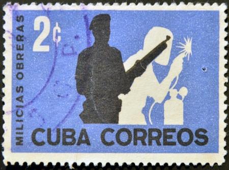 militia: CUBA - CIRCA1962: A stamp printed in cuba shows workers militia, circa 1962