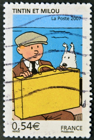 FRANCE - CIRCA 2007: A stamp printed in France shows Tintin and Snowy, circa 2007 Stock Photo - 12531943