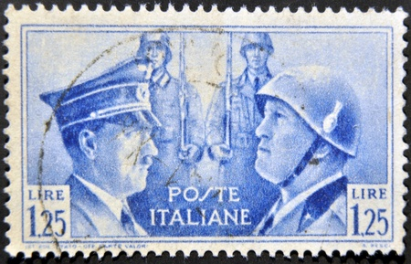 fascism: ITALY - CIRCA 1941: mail stamp printed in Italy showing Hitler and Mussolini face to face, circa 1941  Editorial
