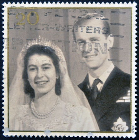 queen elizabeth ii: UNITED KINGDOM - CIRCA 1997: A stamp printed in Great Britain shows Queen Elizabeth II and Prince Philip on the day of the wedding, circa 1997 Editorial