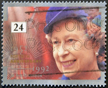 regalia: UNITED KINGDOM - CIRCA 1992: A stamp printed in England, is dedicated to the 40th anniversary of accession to the throne, shows Queen Elizabeth II, circa 1992  Editorial
