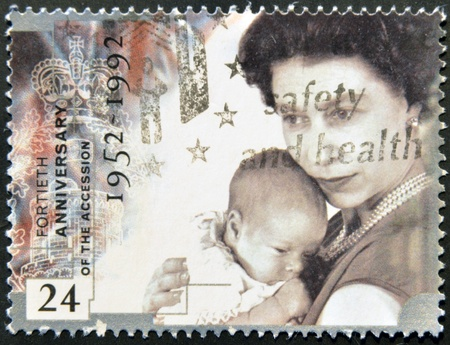 accession: UNITED KINGDOM - CIRCA 1992: A stamp printed in England, is dedicated to the 40th anniversary of accession to the throne, shows Queen Elizabeth II, circa 1992  Editorial