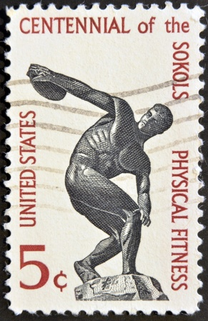 founding: UNITED STATES OF AMERICA - CIRCA 1965: a stamp printed in USA shows Discus thrower, centenary of founding Sokol, athletic organization in America, circa 1965