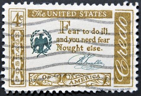 credo: UNITED STATES OF AMERICA - CIRCA 1960 : A stamp printed in USA shows Credo Fear to do ill, and you need fear Nought else, circa 1960