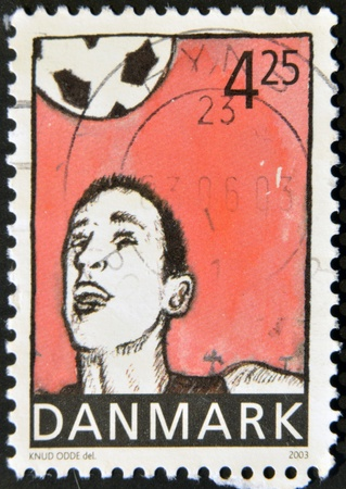 DENMARK - CIRCA 2003: A stamp printed in Denmark shows football player hitting the ball with the head, circa 2003