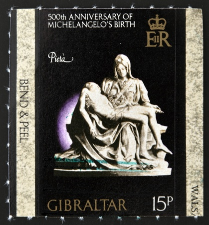 GIBRALTAR - CIRCA 1975: A stamp printed in Gibraltar dedicated to 500th anniversary of Michelangelo´s birth, shows la pieta, circa 1975 Stock Photo - 12570897