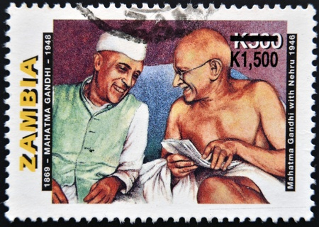 ZAMBIA - CIRCA 1998: A stamp printed in Zambia shows Mahatma Gandhi with Nehru, circa 1998 Stock Photo - 12570938