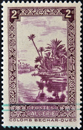 vintage riffle: ALGERIA - CIRCA 1936  stamp printed in Algeria shows Oued River at Colomb-Bechar, circa 1936