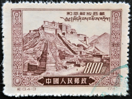 CHINA - CIRCA 1952: A stamp printed in China dedicated to peaceful liberation of Tibet&quot, shows panoramic views of the Potala Palace in Tibet, circa 1952  photo