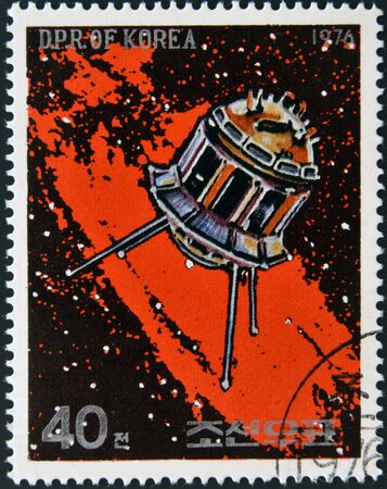 commemorative: NORTH KOREA - CIRCA 1976  A stamp printed in North Korea shows a space station against a sea of stars and the Milky Way galaxy, circa 1976  Stock Photo