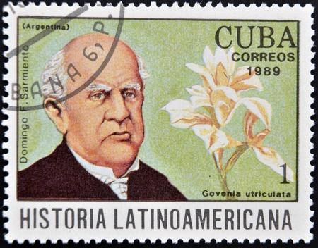 sarmiento: CUBA - CIRCA 1989  A stamp printed in CUBA dedicated to Latin American history shows a Govenia utriculata and Domingo F Sarmiento, circa 1989