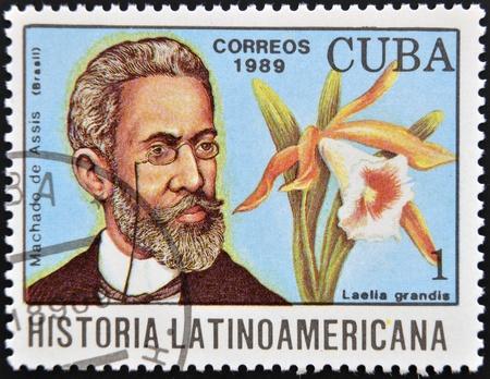 CUBA - CIRCA 1989  A stamp printed in CUBA dedicated to Latin American history shows a Laelia grandis and Machado de Assis, circa 1989