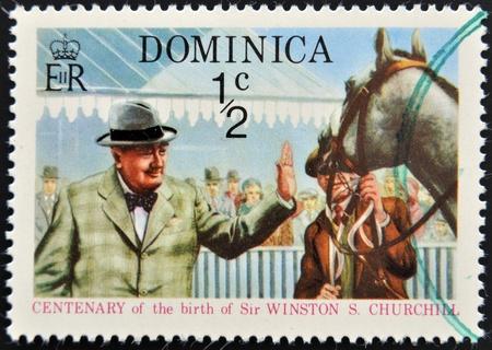 DOMINICA - CIRCA 2009 : A stamp printed in Dominica shows Winston Leonard Spencer Churchill at horse, circa 2009 Stock Photo - 12971572