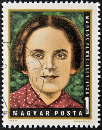 HUNGARY - CIRCA 1972  A stamp printed in Hungary shows Flora Martos, Hungarian Labor Party leader, circa 1972
