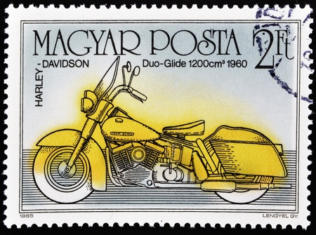 HUNGARY - CIRCA 1985  A stamp printed in Hungary shows Harley Davidson, Duo-Glide 1200 cm 1960, circa 1985   photo