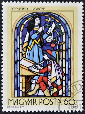 16th century: HUNGARY - CIRCA 1972  A stamp printed in Hungary, shows Stained-glass Window, 16th century scribe, by Ferenc Sebesteny, circa 1972
