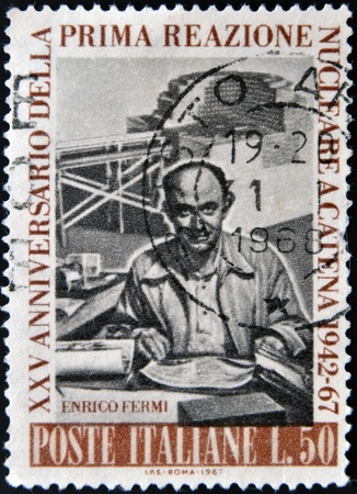 physicist: ITALY - CIRCA 1967   stamp printed in Italy shows Enrico Fermi Italian American physicist, circa 1967  Editorial