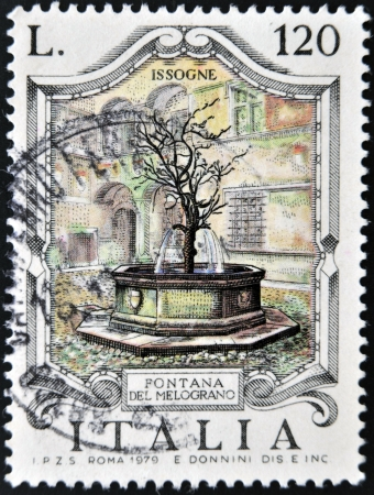 ITALY - CIRCA 1979: A stamp printed in Italy shows Fountain of the Pomegranate, Issogne, circa 1979  photo