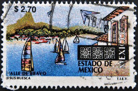 circa: MEXICO - CIRCA 1997: A  stamp printed in Mexico shows sailboats and buildings at the resort town of Valle de Bravo in the Estado de Mexico,circa 1997  Stock Photo
