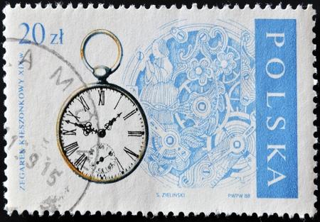POLAND - CIRCA 1988  A stamp printed in Poland showing ancient clock, circa 1988  photo