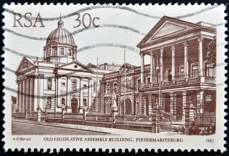 REPUBLIC OF SOUTH AFRICA - CIRCA 1982  A stamp printed in RSA shows old legislative assembly building, circa 1982  photo