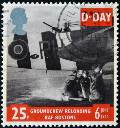 reloading: UNITED KINGDOM - CIRCA 1994  a stamp printed in the Great Britain shows Ground Crew reloading FAF Bostons, 50th anniversary of D-Day, circa 1994