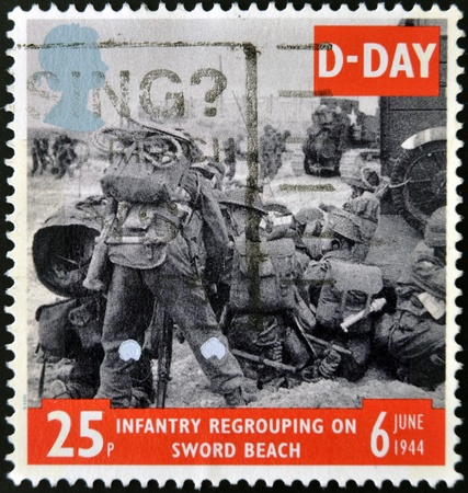 UNITED KINGDOM - CIRCA 1994  a stamp from the UK shows image of soldier on Sword Beach in Normandy, infantry regroupong on sword beach, commemorating D-Day, circa 1994