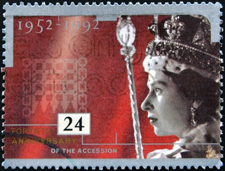 queen elizabeth: UNITED KINGDOM - CIRCA 1992  A stamp printed in England, is dedicated to the 40th anniversary of accession to the throne, shows Queen Elizabeth II, circa 1992