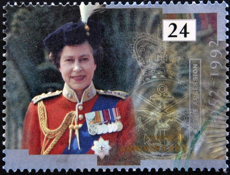 queen elizabeth ii: UNITED KINGDOM - CIRCA 1992  A stamp printed in England, is dedicated to the 40th anniversary of accession to the throne, shows Queen Elizabeth II, circa 1992