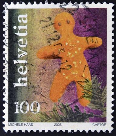SWITZERLAND - CIRCA 2005  A stamp printed in Switzerland shows gingerbread, circa 2005 photo