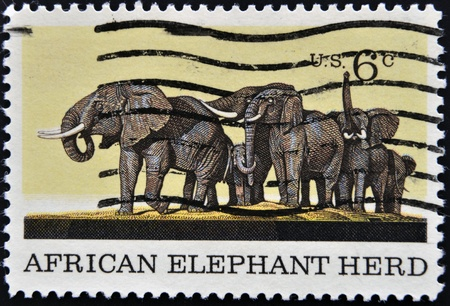 UNITED STATES OF AMERICA -CIRCA 1970  A stamp printed in USA shows a picture of African Elephant Herd, circa 1970  photo