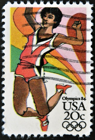 UNITED STATES OF AMERICA - CIRCA 1984  A stamp printed in USA from the Los Angeles Olympics 1984 issue, showing long jump, circa 1984   Stock Photo - 12971542