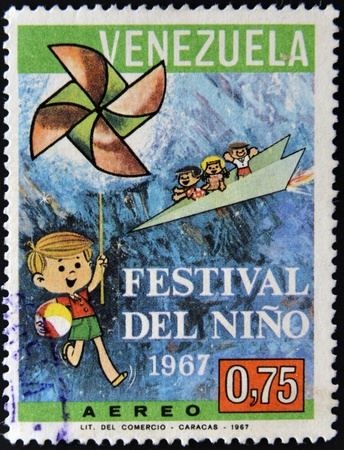 VENEZUELA - CIRCA 1967  A stamp printed in Venezuela dedicated to children s festival, circa 1967 photo