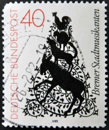 shrewd: GERMANY - CIRCA 1982: A stamp printed in Germany shows cartoon drawing of trotamusicos, circa 1982