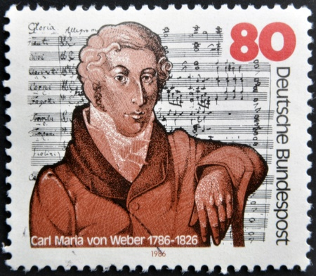 weber: GERMANY - CIRCA 1986: A stamp printed in the Germany, shows Carl Maria von Weber on the background Mass in E-flat Major, circa 1986  Stock Photo