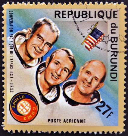 BURUNDI - CIRCA 1975: A stamp printed in Burundi shows American astronauts Jack R. Lousma, Ronald Evans and Alan Bean, circa 1975